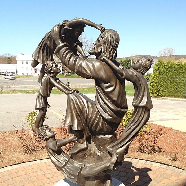 jesus with kids sculpture