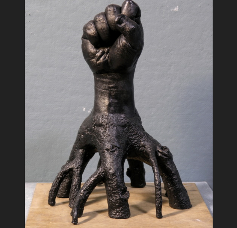 abstract clenched hand statue
