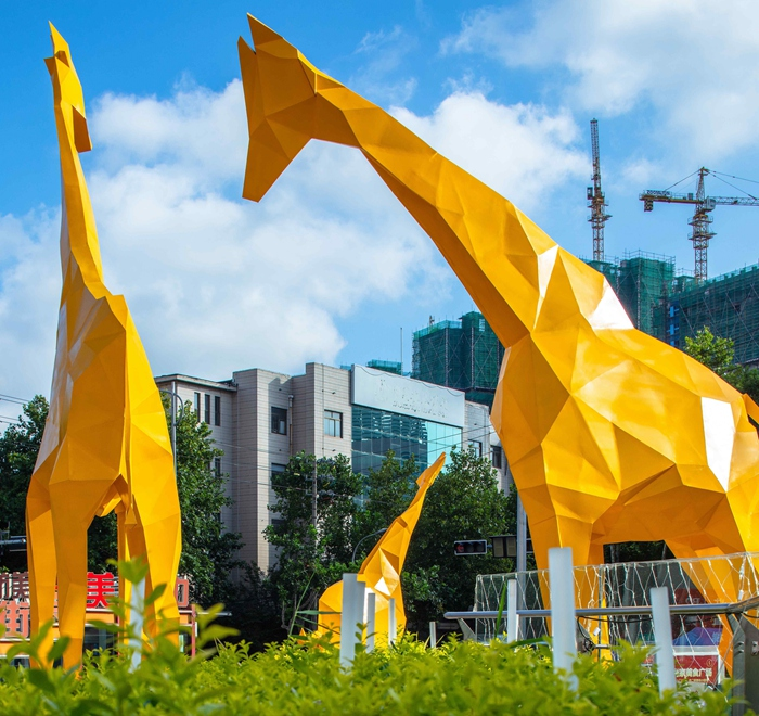 yellow giraffe sculpture