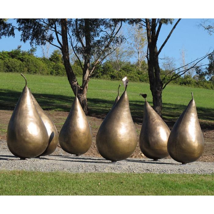 golden water droplets sculpture
