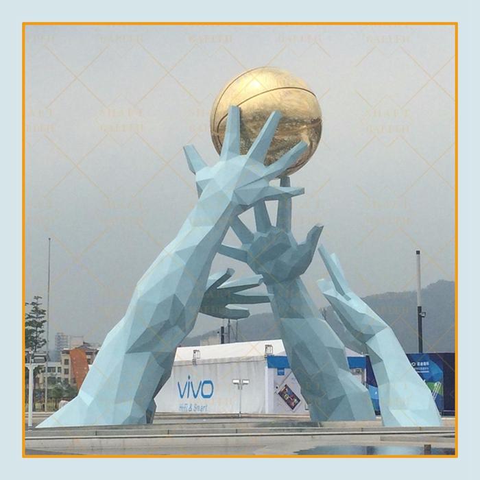 blue hands scuilpture