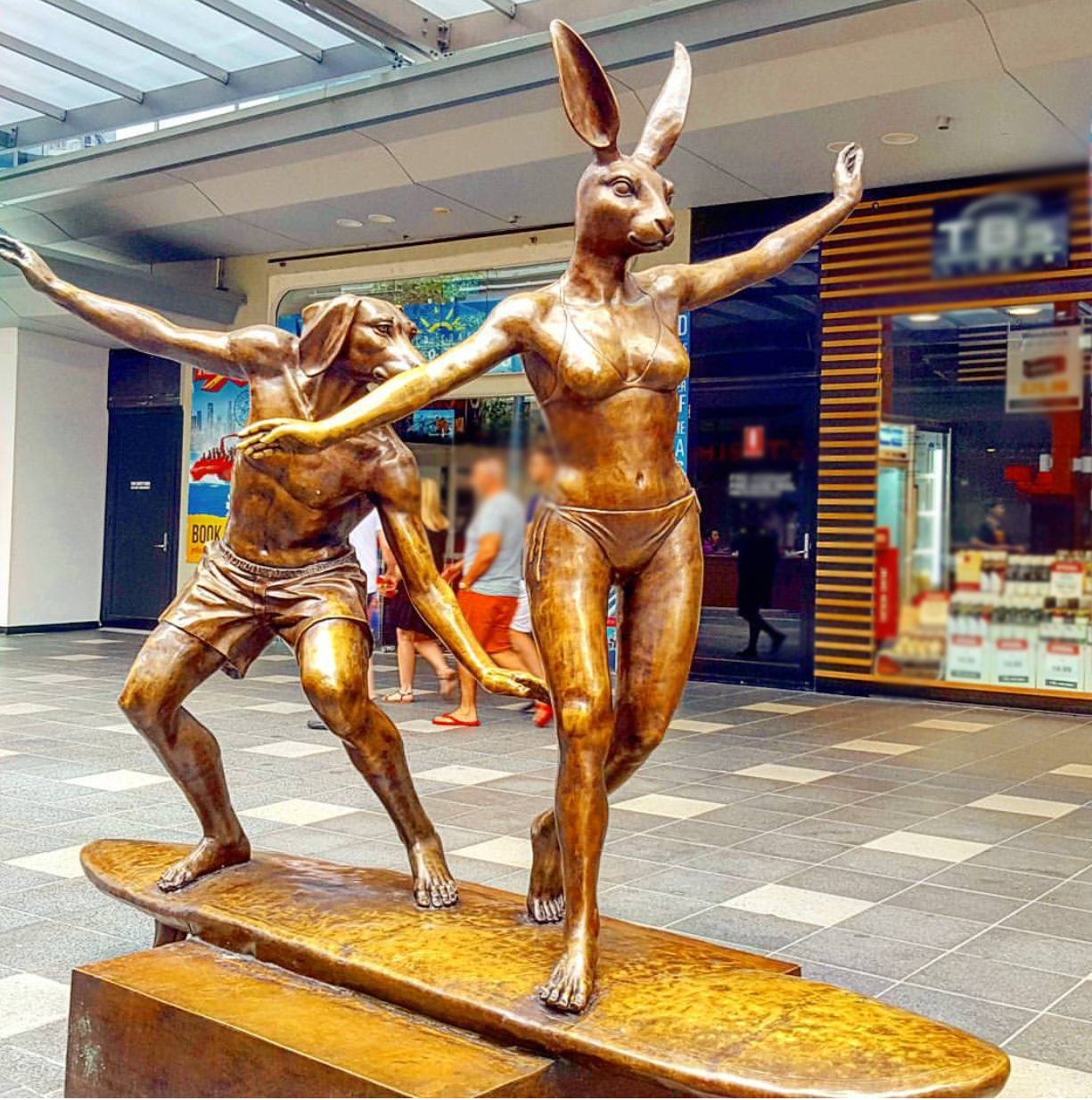 Dancing rabbit and dog bronze statue