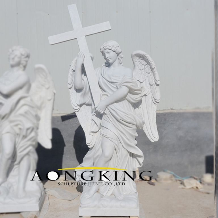 Statue of angel carrying cross