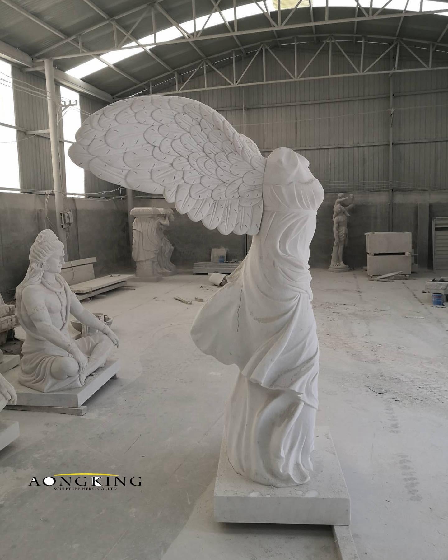 Marble nike of samothrace statue