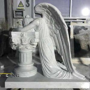 Kneeling angel sculpture