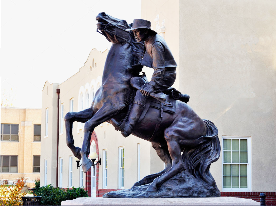 bronze statue of cowboy and horse