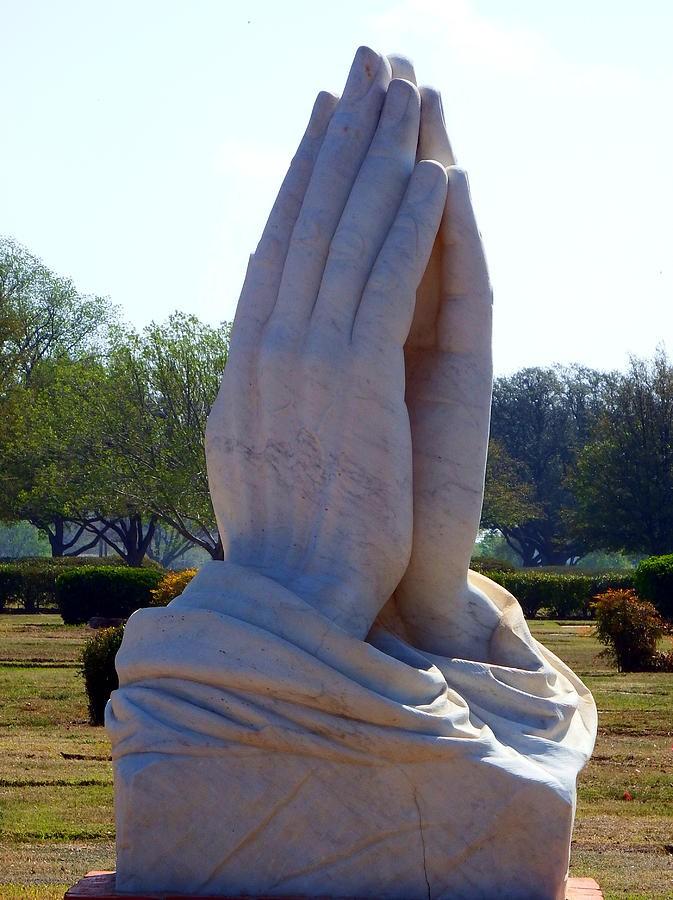 Praying hands statue