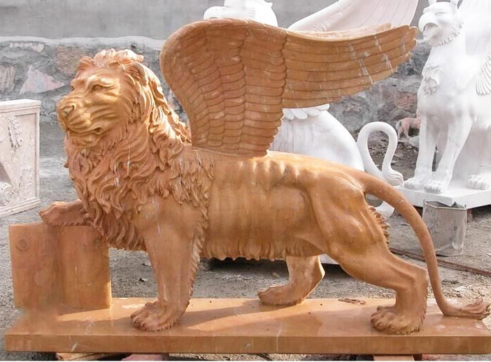 carving lion statue with wings