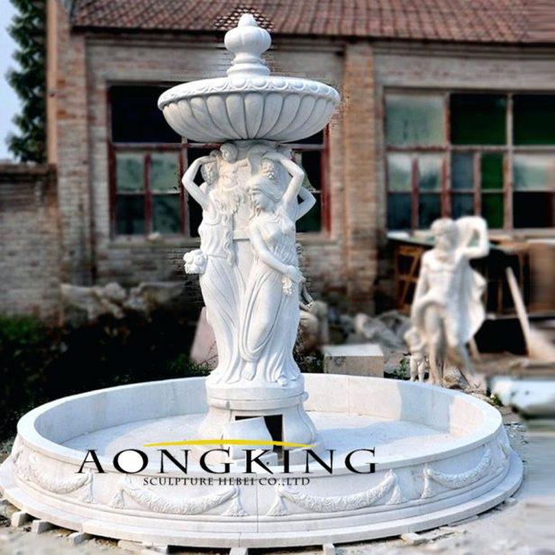 women water fountain statues