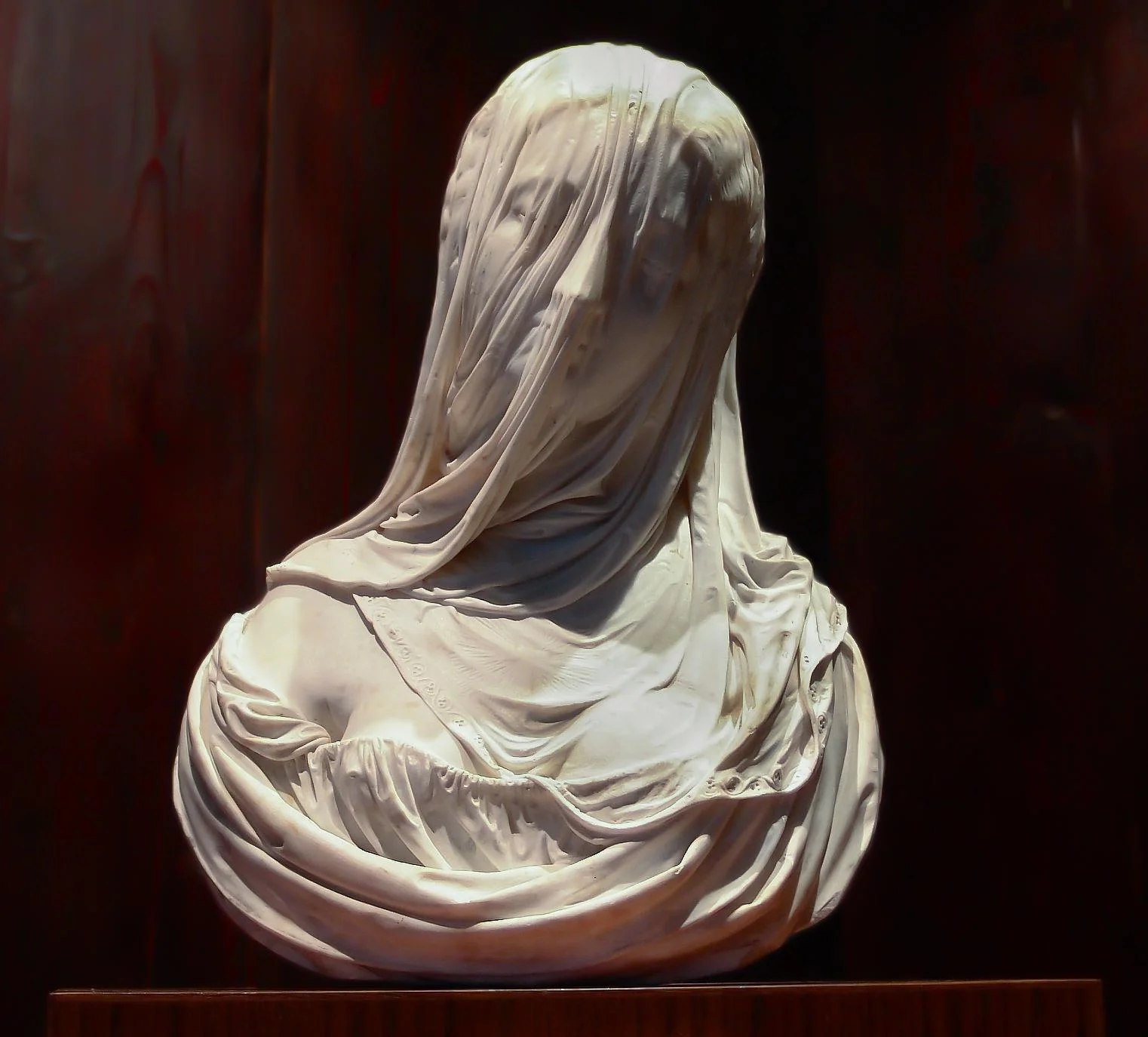 marble statue of woman with veil