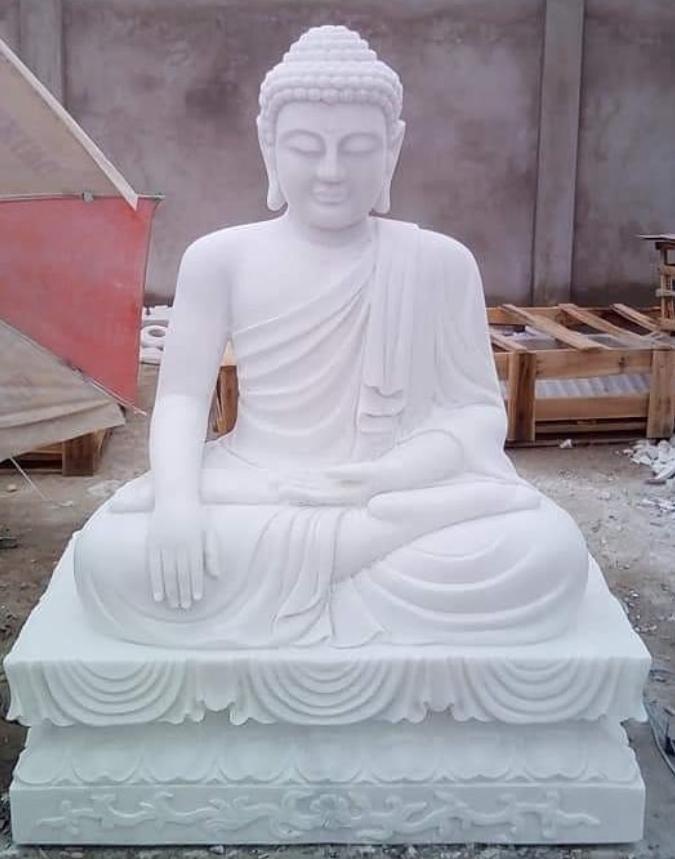 white stone buddha