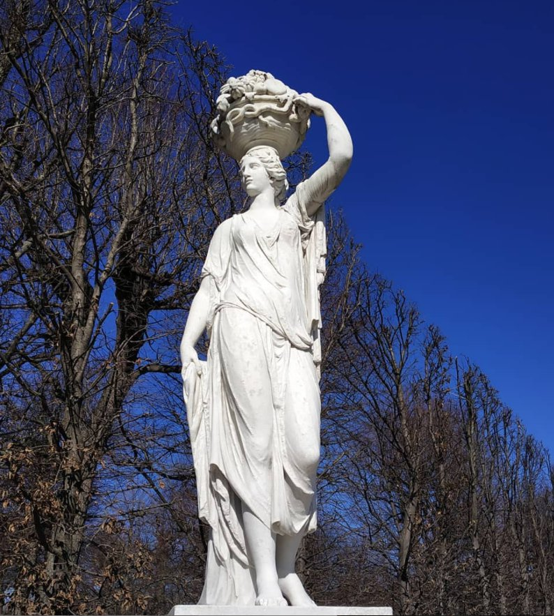 white stone statue of lady
